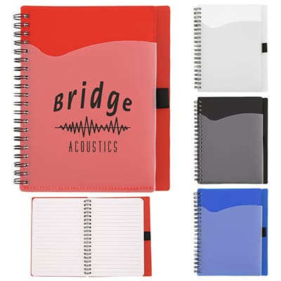 Branded red notebook with front pocket and pen holder.