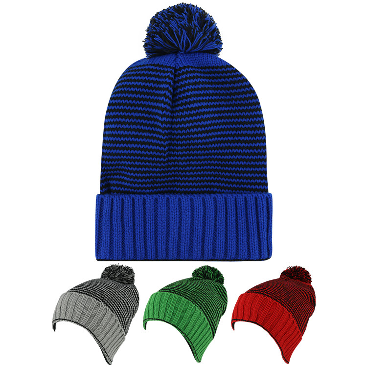 Blank royal blue with black beanie with pom.